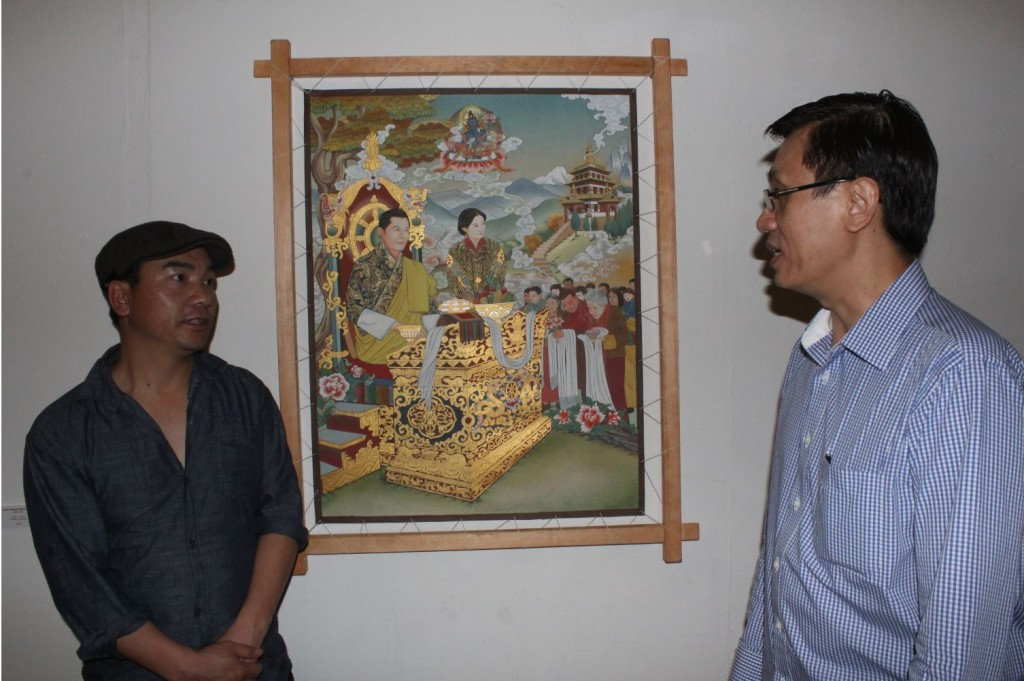 "Rinchen Wangdi (at left) beside his painting ""King"""